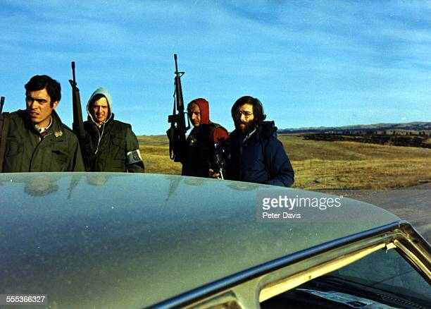 Armed Federal Marshals search the car and equipment of a group of journalists at an Federal Bureau of Investigation roadblock during the American...