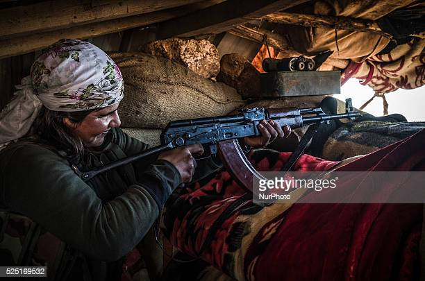 Armed female fighter of the Syrian Kurdish People's Protection Units are seen on the defense line around Kobane on 26 December 2014