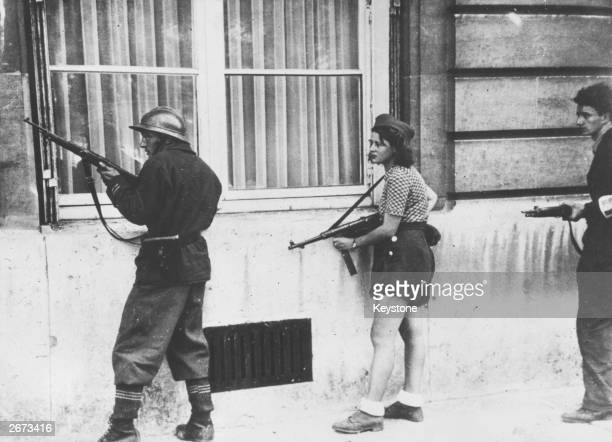 Armed fighters on guard during the Liberation of Paris
