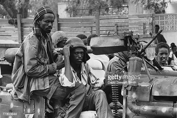 Armed fighters sitting in a car in Mogadishu during the civil war in Somalia January 1992