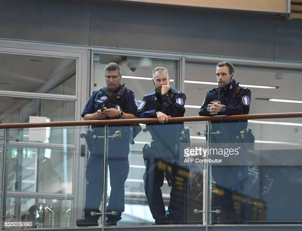 Armed Finnish policemen on guard at the Helsinki airport on August 18 2017 Several people were stabbed in the southwestern Finnish city of Turku on...