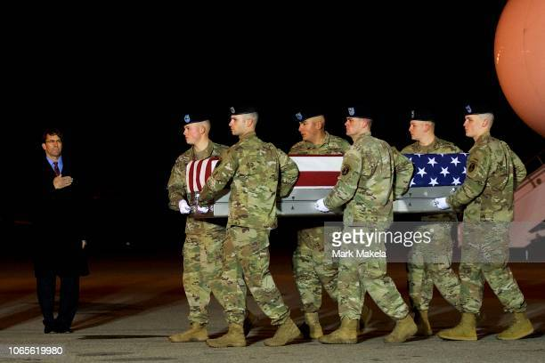Armed forces carry a transfer case covered with an American flag during a dignified transfer for fallen service member Sergeant Leandro AS Jasso on...