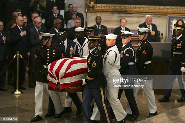 US Armed Forces carry former president Ronald Reagan's casket to the viewing at the Capitol Building June 9 2004 in Washington DC