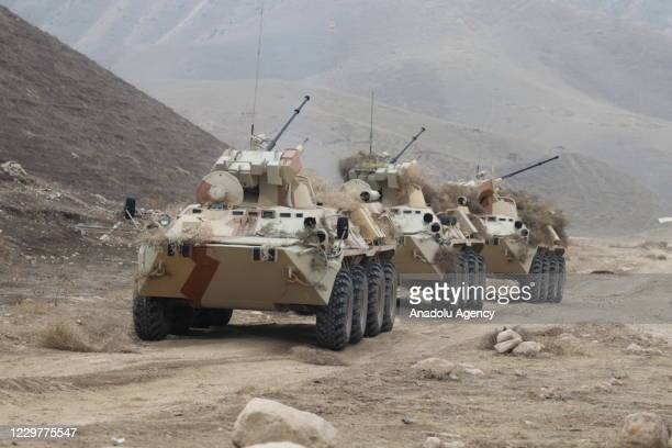 Armed forces of Tajikistan and the Russian troops of the Russian military base conduct a joint military drill near Afgan-Tajik border in Sambuli,...