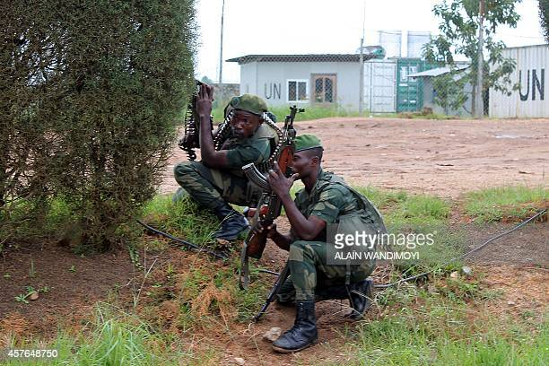 Armed Forces of the Democratic Republic of the Congo stand guard at the UN mission MONUSCO base in Mavivi as people demonstrate against the MONUSCO...