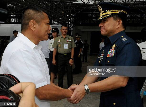 Armed Forces of the Philippines Chief General Eduardo Oban Jr congratulates former Philippine Marine colonel Ariel Querubin after he 135 other former...