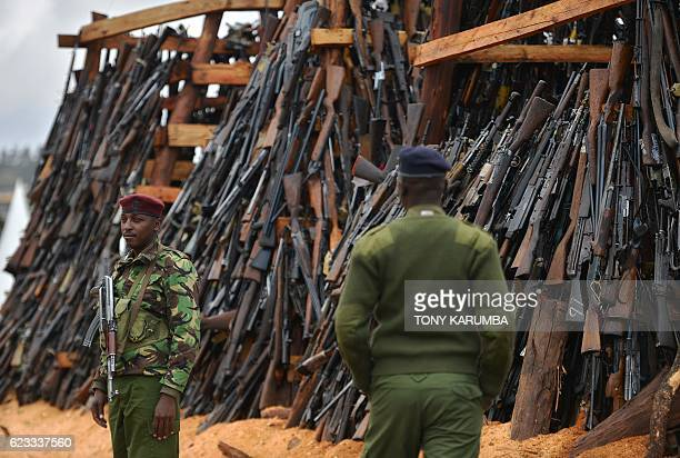 Armed forces secure a stockpile of illegal arms confiscated from a variety of criminals before being set ablaze in Ngong in Kajiado county on...