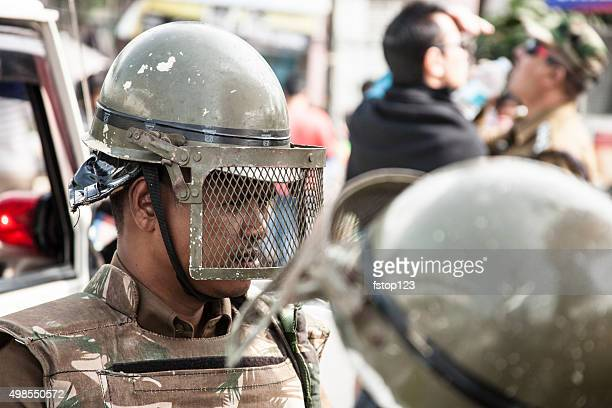 Armed Forces, State Police in riot gear in northern India.