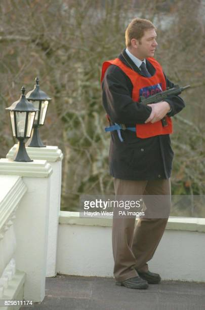 Armed Gardai at the house of registered money lender Ted Cunningham in Farran Co Cork Ireland who was arrested yesterday after 23m was discovered in...