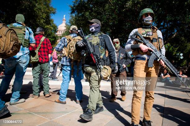 Armed groups hold a rally in front of a closed Texas State Capitol in Austin, Texas,on January 17, 2021 during a nationwide protest called by...