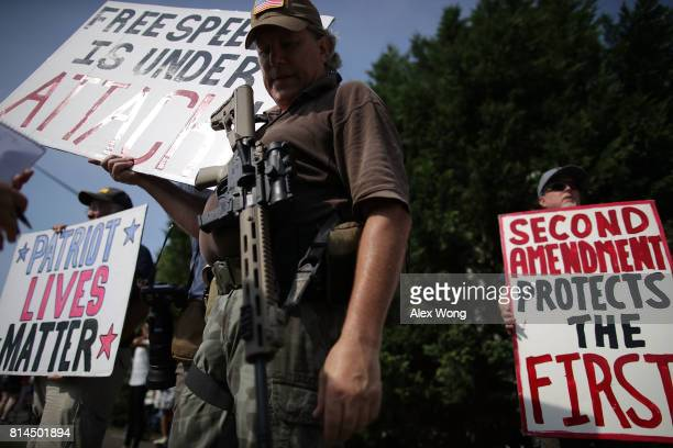 Armed gun rights activists counterprotest during a guncontrol rally outside the headquarters of National Rifle Association July 14 2017 in Fairfax...