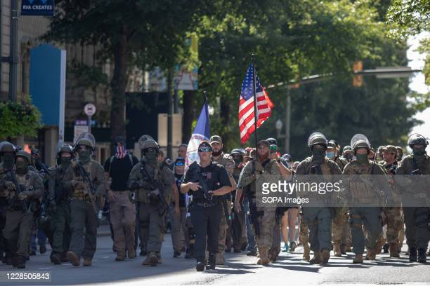 Armed gun rights protesters march down Broad Street. Protesters led by Boogaloo Boy Mike Dunn, protested against new firearm restrictions that were...