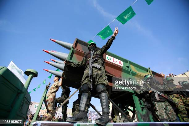 Armed Hamas militants seen next to missiles during the rally. Palestinian Hamas staged an anti-Israel rally in the northern Gaza Strip, a parade with...