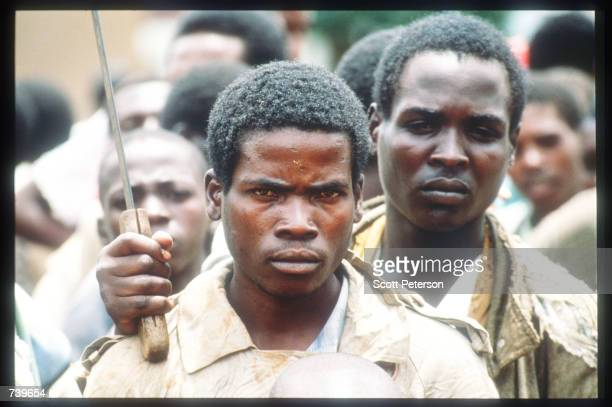 Armed Hutus wait outside a United Nations compound housing Tutsi people April 13 1994 in Kigali Rwanda Following the apparent assassination of...