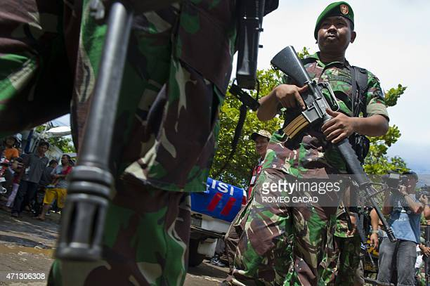 Armed Indonesian soldiers arrive at the Nusakambangan port in Cilacap where officials and visitors ride the ferry to Nusakambangan maximum security...