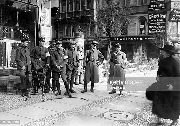 Armed insurgency of supporters of the German Communist Party against the government in Berlin sentry of troups loyal to the government on a street in...
