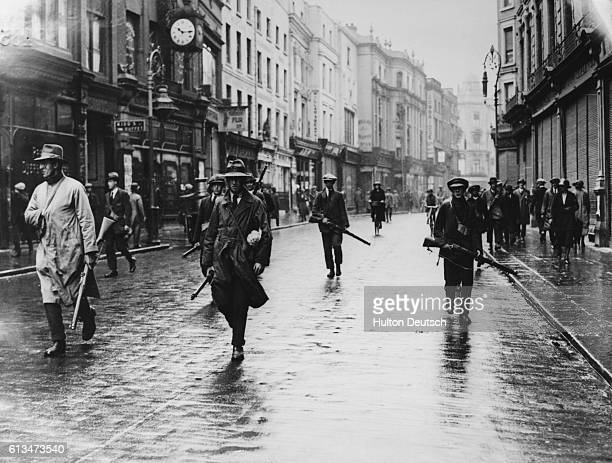 Armed IRA rebels in the streets during the Battle of Dublin