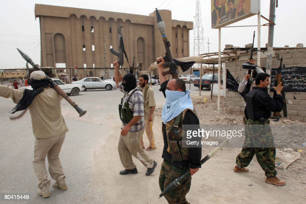 Armed Iraqi Mahdi army militiamen, loyal to the radical Shiite cleric Moqtada al-Sadr, chant slogans on March 28, 2008 in the city of Basra south of...