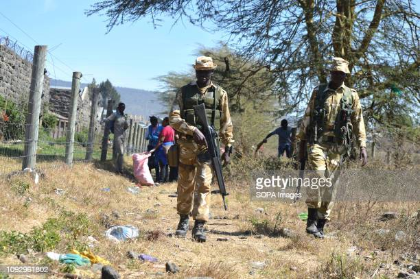 PARK NAKURU RIFTVALLEY KENYA Armed Kenya Wildlife Service rangers seen walking a head of students who are conducting a cleanup exercise during this...