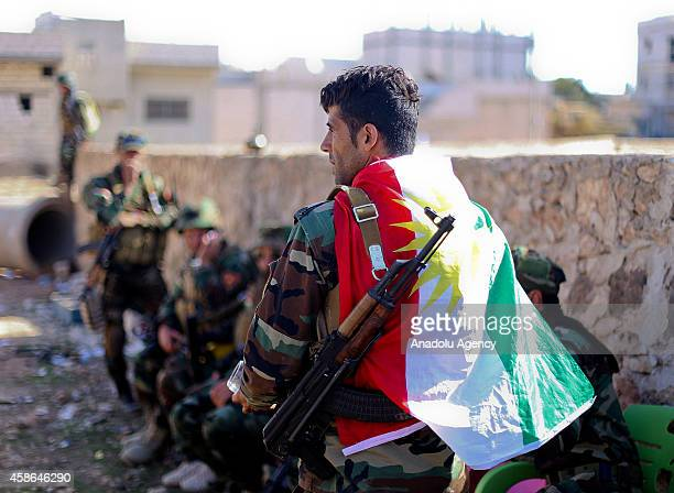 Armed Kurdish fighters are seen during the clashes with Islamic State of Iraq and Levant members in Kobani Syria on November 8 2014 According to the...