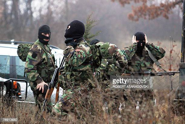 Armed Macedonian soldiers arrive at the scene of a wreckage of a crashed military helicopter in the village Kozhle 25 km east from the capital...