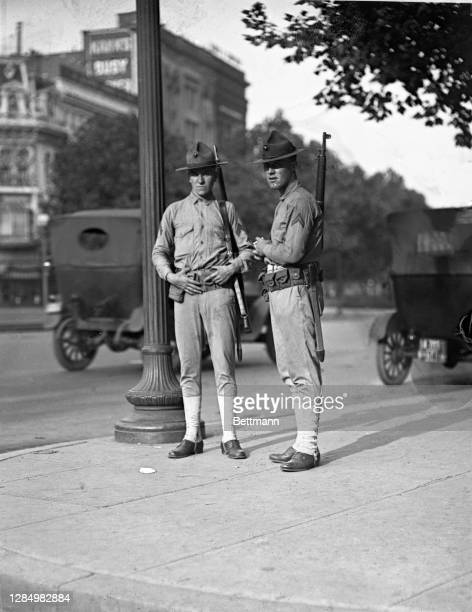 Armed Marines from Quantico barracks on guard duty on Pennsylvania Avenue, Washington, D.C. Despite the fact that the city has resumed its normal...
