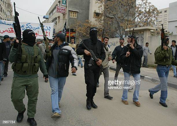 Armed members from the Populer Resistance Committees demonstrate 10 February 2004 in Gaza City against the arrest of four of their comrads who were...