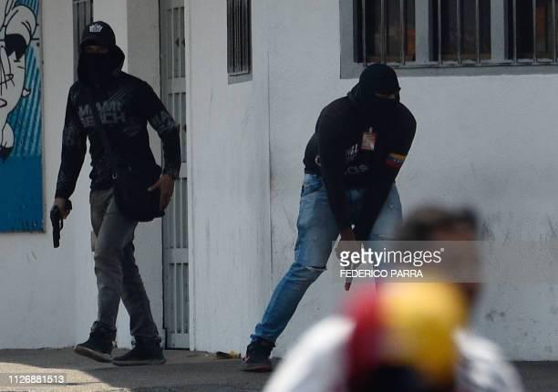 TOPSHOT Armed members of a proMaduro militia attempt to disperse opposition demonstrators in San Antonio del Tachira Venezuela on February 23 2019...