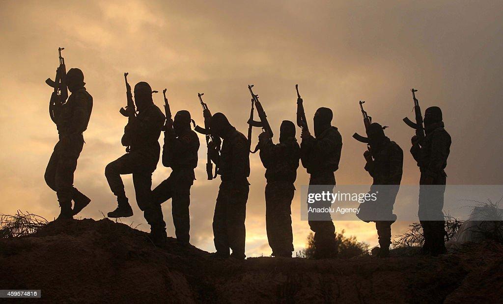 Armed members of Islamic Jihad Movement, Al-Quds Brigades, are seen during a training in Deir al-Balah city of Gaza on November 25, 2014.