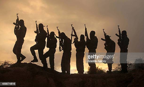 Armed members of Islamic Jihad Movement AlQuds Brigades are seen during a training in Deir alBalah city of Gaza on November 25 2014
