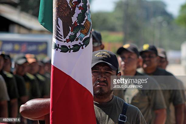 Armed members of Regional Coordinator of Community Authorities participate in a parade at the main square of San Luis Acatlan Guarrero state Mexico...