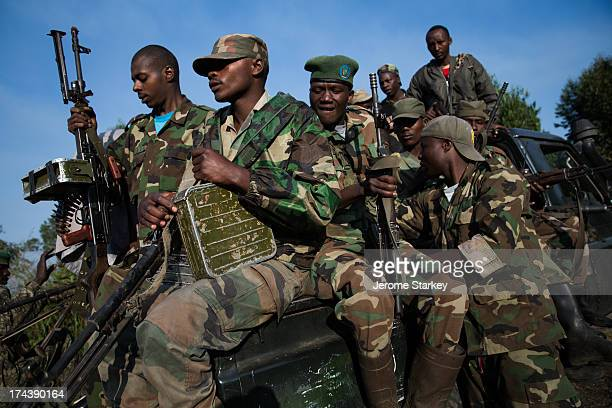 Armed members of the M23 rebel group travel to a frontline position overlooking Goma, in the shadow of the Nyiragongo Volcano, in the eastern...