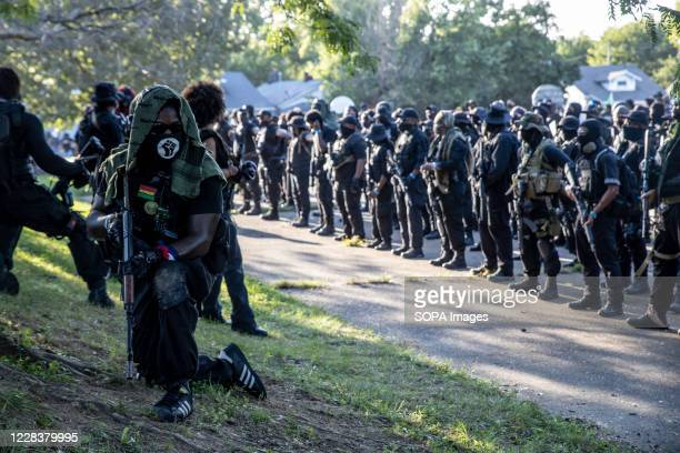 Armed members of the Not Fucking Around Coalition , a Black militia, form ranks after leaving Churchill Downs. Breonna Taylor was killed on March 13,...