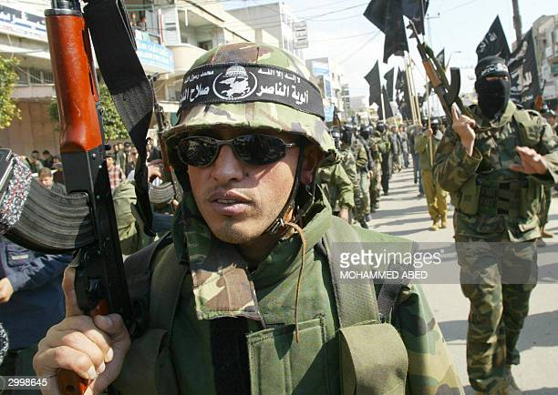 Armed members of the Popular Resistance Committees demonstrate 20 February 2004 in Gaza City against the arrest of four of their comrades who were...
