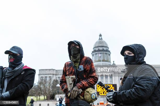 Armed members of the right-wing subsection of the militia coined the Boogaloo Boys protest outside of the Capitol on January 17, 2021 in Frankfort,...