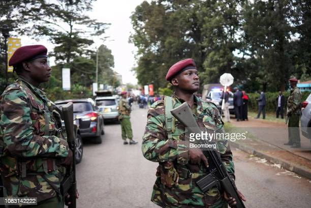 Armed members of the security forces stand guard at the 14 Riverside Drive hotel and office complex in the Westlands district of Nairobi Kenya on...