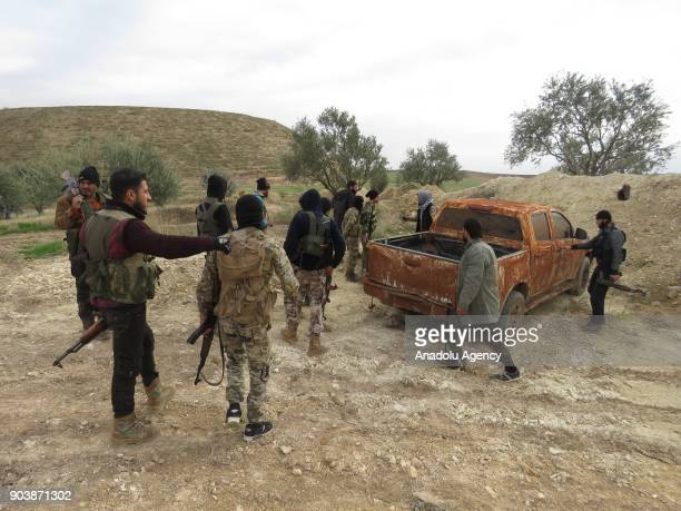 Armed men are seen around a pickup truck in Idlib Syria on January 11 2018 Assad Regime and its supporter terrorist groups continue their attacks in...