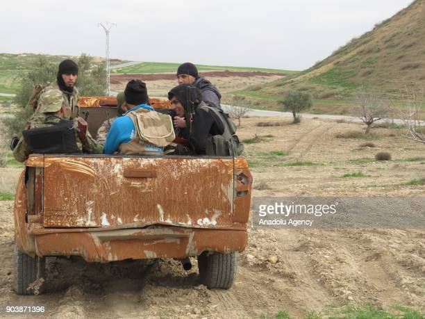 Armed men are seen in the back of a pickup truck in Idlib Syria on January 11 2018 Assad Regime and its supporter terrorist groups continue their...
