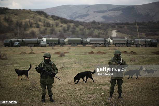 Armed men believed to be Russian military patrol outside a Ukrainian military base on March 12, 2014 in Simferopol, Ukraine. As the standoff between...