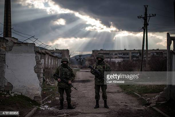 Armed men believed to be Russian military stand outside a Ukrainian military base on March 12, 2014 in Simferopol, Ukraine. As the standoff between...