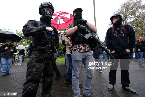 Armed men carrying assault rifles join protesters at the ReOpen Oregon Rally on May 2 2020 in Salem Oregon United States Demonstrators gathered at...