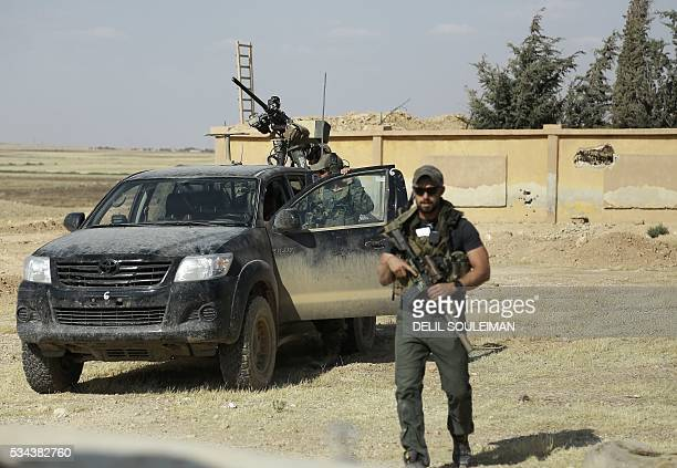 Armed men identified by Syrian Democratic forces as US special operations forces are seen in the village of Fatisah in the northern Syrian province...