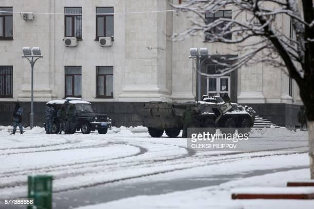 Armed men in military fatigues block access to government buildings in eastern Ukraine's rebelheld Lugansk on November 22 2017 The patrols began...