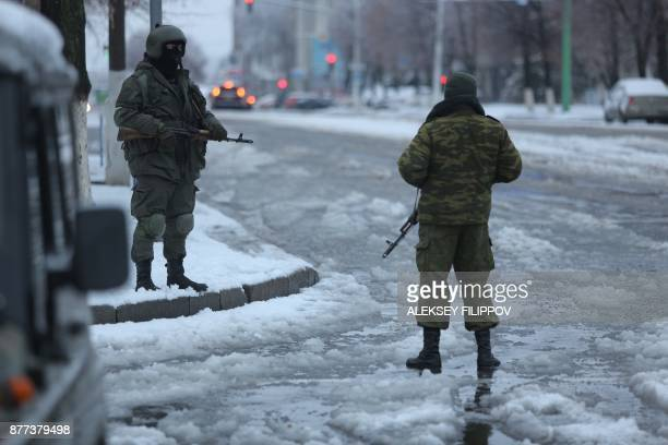 Armed men in military fatigues block access to the government buildings in eastern Ukraine's rebelheld Lugansk on November 22 2017 The patrols began...
