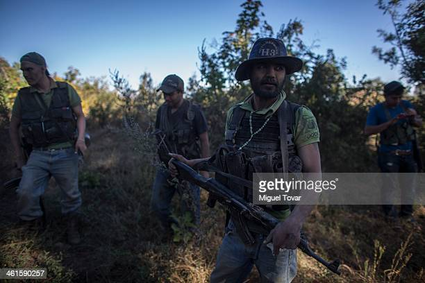 Armed men of the selfdefense group patrol the mountain range at the outskirt of Paracuaro in the state of Michoacan Mexico Despite some success by...