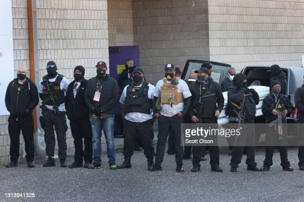 Armed men shield the view of Daunte Wright's casket arriving at Shiloh Temple International Ministries for his funeral service on April 22, 2021 in...