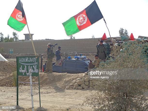 Armed men under the leadership of MP Zahir Qadir stand guard as 4 Daesh militants are executed in Acin town of Nangarhar province Afghanistan on...