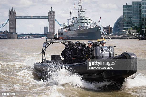 Armed Metropolitan Police counter terrorism officers take part in an exercise on the River Thames in London on August 3 2016 Metropolitan Police...