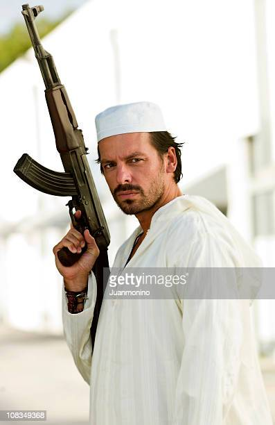 armed middle eatern man - pakistani soldiers stock photos and pictures