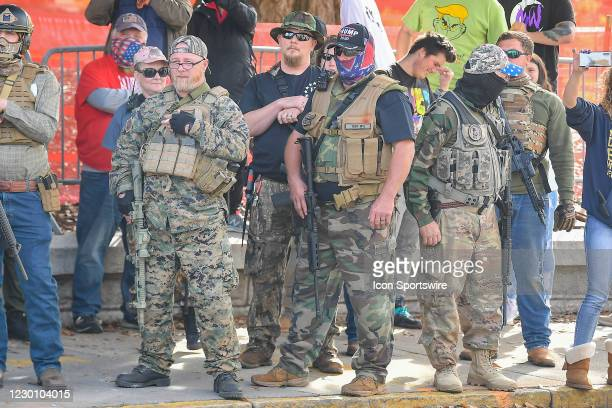 Armed militia members watch members of Antifa during a Stop The Steal protest at the Georgia State Capitol on December 12th, 2020 in Atlanta, GA.